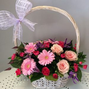 arrangement of flowers in a basket