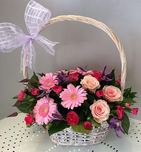 arrangement of flowers in a basket