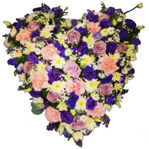 Solid heart shape arrangement of loose flowers