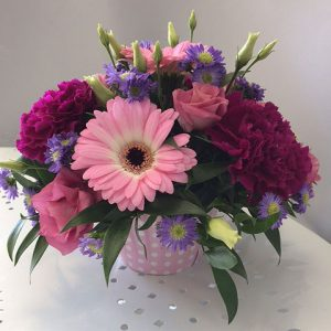 Arrangement of flowers in a cupcake