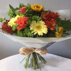 Hand tied arrangement with stems out