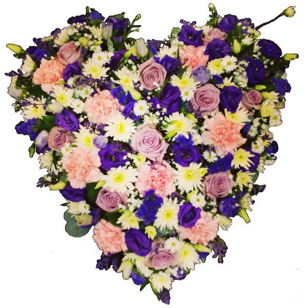 Solid heart shape arrangement of loose flowers